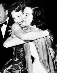 Rosalind hugging Loretta at the Oscars, 1948