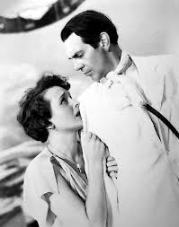 Mary Astor as Madame De Laage with Raymond Massey as Governor De Laage.