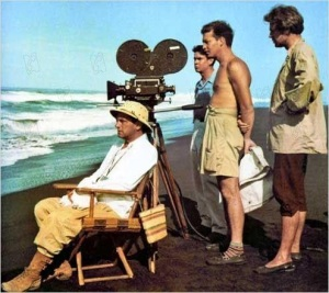 Director Bunuel, crew, and actor O'Herlihy in an early production shot from Robinson Crusoe.